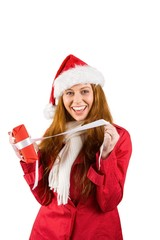 Festive redhead opening a gift