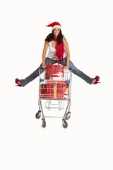 Woman jumping with shopping trolley