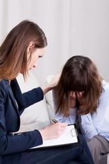Young psychotherapist listening in focus