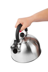 Stovetop whistling kettle in hand