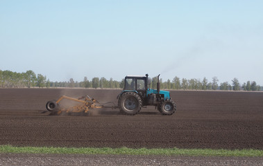 Tractor plowing the ground