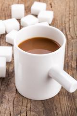 Coffee and sugar on the wood board