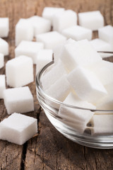 Close up sugar cube on wood  background