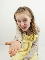 small girl showing gap in teeth