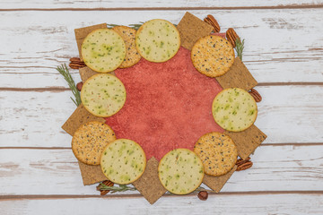 Selection of crackers on red tile
