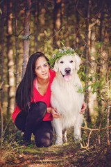 Beautiful girl with her dog in the forest