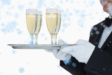 waiter carrying tray full glasses of champagn