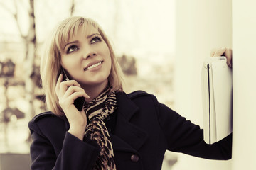 Happy young woman calling on the cell phone