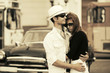 Young fashion couple in love at the retro car