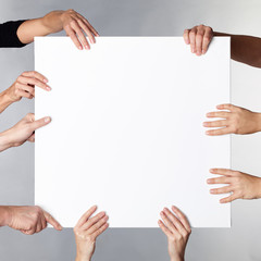 Many hands showcase a white board