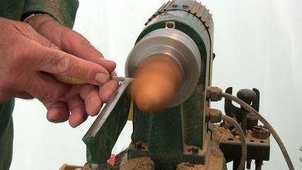Craftsman turning wood on lathe machine