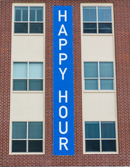 Happy Hour Sign on Brick