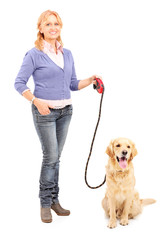 Mature lady holding a dog on a leash