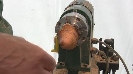 Craftsman wax polishing wooden souvenir