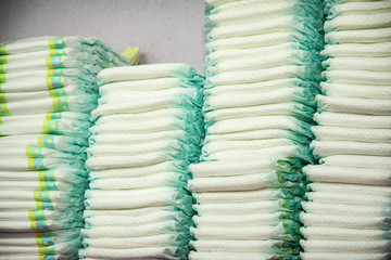Diapers stacked in a piles