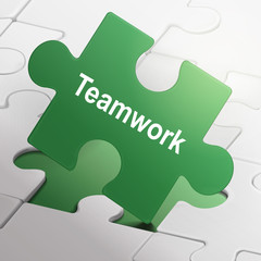 teamwork word on green puzzle pieces