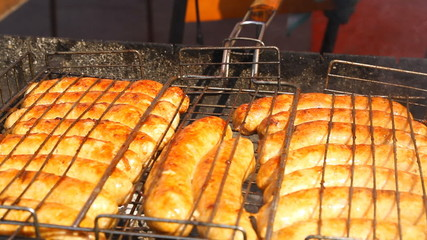 Sausages fried on a grill