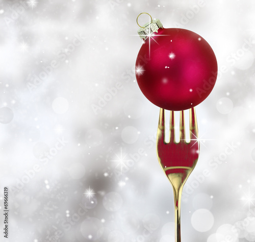 Golden fork with Christmas ball in a glittery background - 69666319