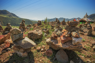 Pyramid of stones on a background of mountains