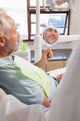 Patient admiring new smile in the mirror