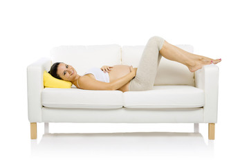 Pregnant woman lying on sofa