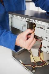Computer engineer working on broken cables