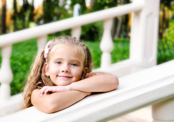 Portrait of adorable little girl in the park