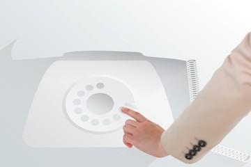Businesswoman pointing against retro telephone