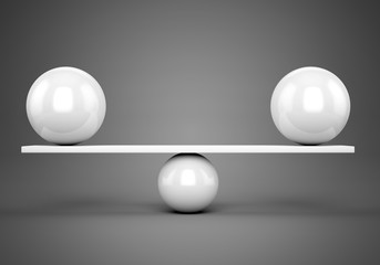 White glossy balls balanced on plank