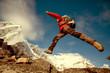 Hiker jumps on the rock near Everest in Nepal