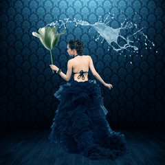 Fabulous Fairy in a lush black dress and with a large flower