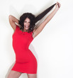 Beautiful young woman in a red dress and long hair