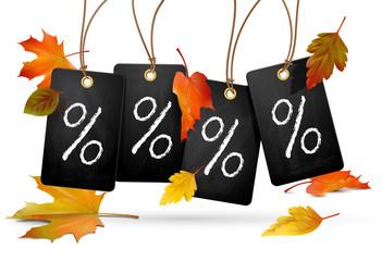 Plaketten mit Prozentzeichen u. Herbstlaub