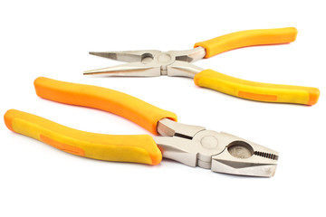 Two yellow pliers isolated on  white