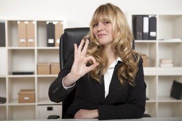 Businesswoman making a perfect gesture