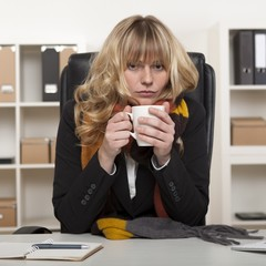 Young girl at work enjoying hot coffee