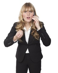 Shocked Business Woman While Calling on Phone