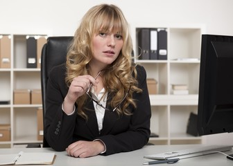Young businesswoman listening carefully
