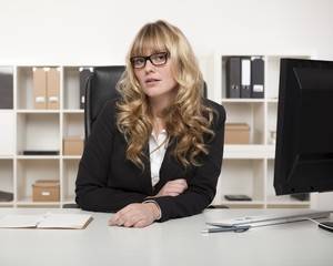 Young businesswoman or manageress in glasses