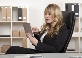 Businesswoman working on a tablet