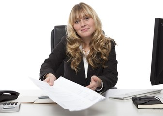 Smiling businesswoman handing over a document