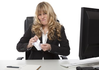 Disgusted businesswoman ripping up paper