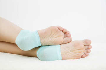 Foot care on gray background