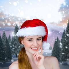 Pretty girl in santa costume smiling