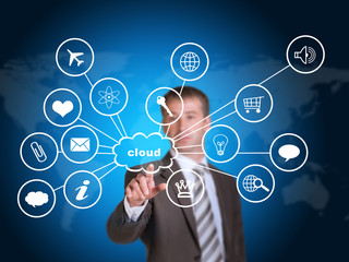 Business man pointing her finger at cloud with computer icons