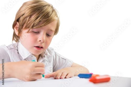 canvas print picture Student using crayons to draw