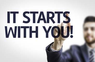 Business man pointing the text: It Starts with You!