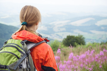 Young woman hiking in the mountains
