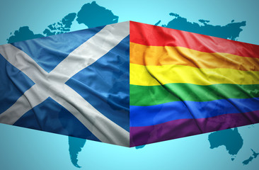 Waving Scottish and Gay flags
