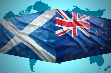 Waving Scottish and New Zealand flags